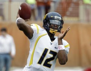 Smith's 4 TD passes lead WVU over Texas, 48-45