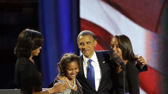 President Barack Obama walks out of the stage with his wife Michelle and daughters Sasha and Malia at his election night party Wednesday, Nov. 7, 2012, in Chicago. President Obama defeated Republican challenger former Massachusetts Gov. Mitt Romney. (AP Photo/Pablo Martinez Monsivais)