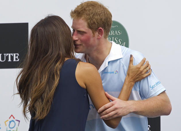 Britain's Prince Harry greets Brazilian model Fernanda Motta during an award ceremony after playing a charity polo match in Campinas, Brazil, Sunday March 11, 2012.  Prince Harry is in Brazil at the r