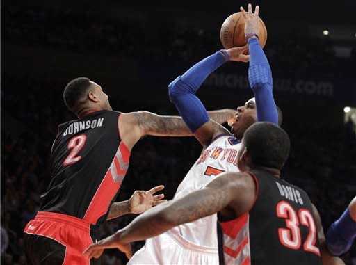 Knicks rout Raptors, 4-0 under Woodson