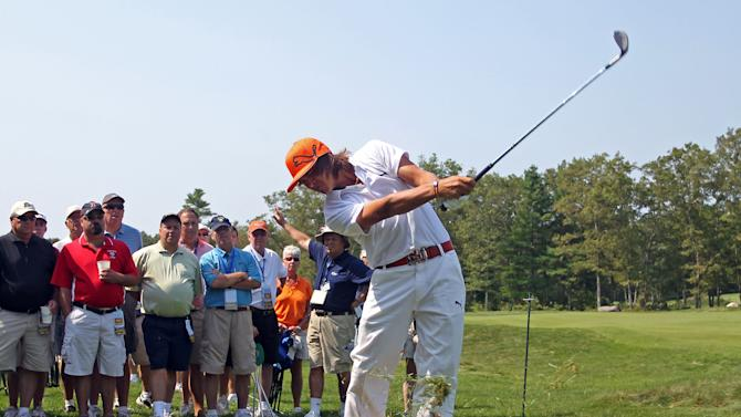 Rickie Fowler hits his second shot on the 15th hole during the second round of the Deutsche Bank Championship golf tournament at TPC Boston, Saturday, Sept. 3, 2011, in Norton, Mass. (AP Photo/Stew Milne)