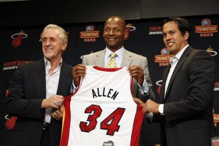 Miami Heat president Pat Riley, left, guard Ray Allen, center, and head coach Erik Spoelstra, right, hold up Allen's jersey after Allen signed an NBA ...