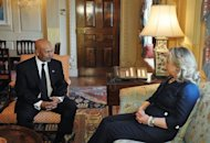 US Secretary of State Hillary Clinton meets with Libyan ambassador Ali Suleiman Aujali at the State Department in Washington. Clinton has condemned an amateur anti-Islam film which has sparked violent Middle East protests, stressing the US government had nothing to do with it