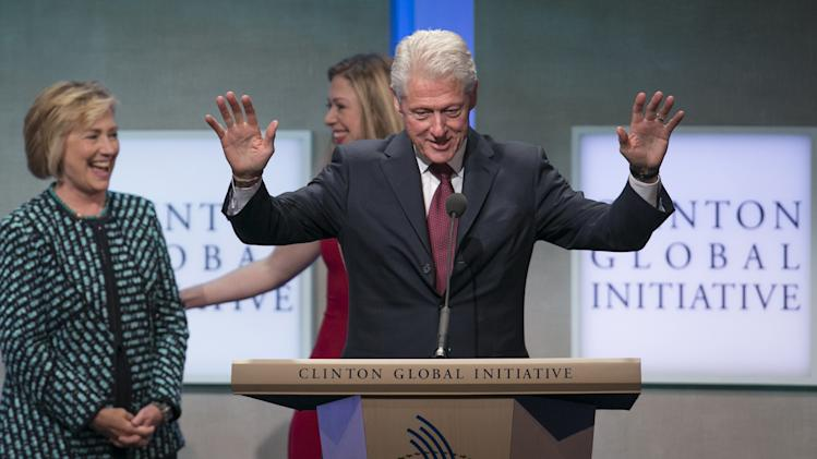 Former U.S. Secretary of State and former first lady Hillary Clinton and daughter Chelsea share a laugh while former U.S. President Clinton speaks at the Clinton Global Initiative 2013 (CGI) in New York