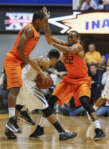 No. 14 Oklahoma State beats West Virginia 73-57