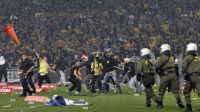 AEK Athens fans clashed with riot police in 2011 at the Olympic stadium in the Greek capital after the home side won the Cup final against Atromitos Peristeri