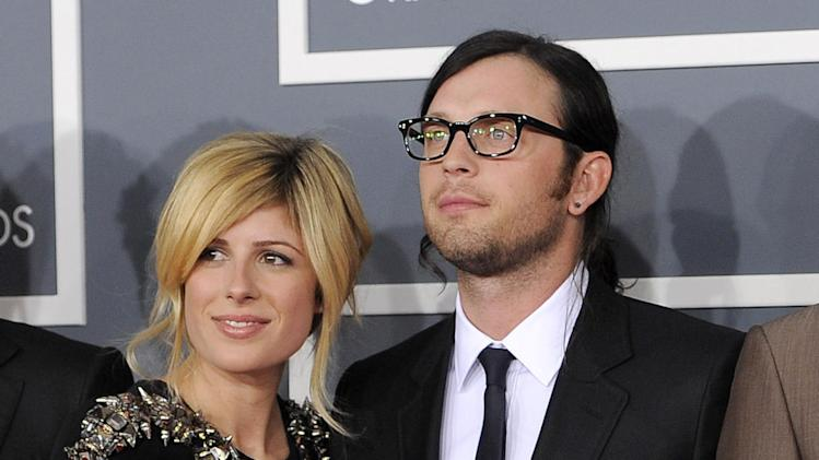FILE - This Feb. 12, 2012 file photo shows Jessie Baylin with her husband Nathan Followill of the band Kings of Leon at the 54th annual Grammy Awards in Los Angeles. Followill and Baylin welcomed a baby girl on Wednesday, Dec. 26, 2012. (AP Photo/Chris Pizzello, File)