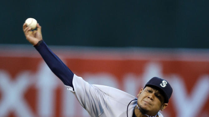 Seattle Mariners' Felix Hernandez works against the Oakland Athletics in the first inning of an opening day baseball game Monday, April 1, 2013, in Oakland, Calif. (AP Photo/Ben Margot)