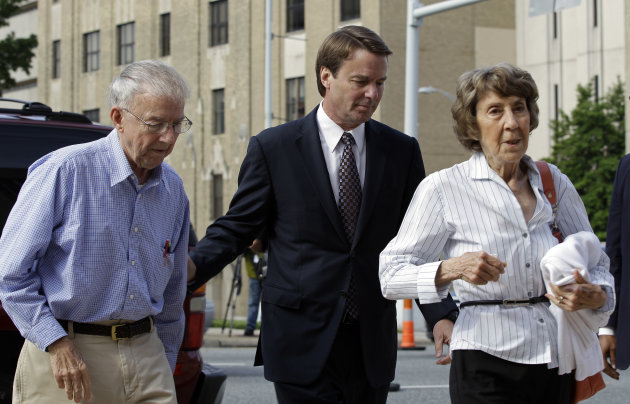 John Edwards, center, and his mother Bobbie Edwards, right, and his father Wallace Edwards, left, arrive at a federal courthouse for John Edwards' trial on charges of campaign corruption in Greensboro