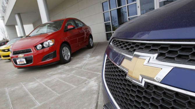 FILE - This Feb. 19, 2012 file photo shows the familiar Chevrolet bowtie logo displayed on the grille of a 2012 Cruze sedan, foreground, with a 2012 Sonic sedan in the background at a Chevrolet dealership in the south Denver suburb of Englewood, Colo. Sunday, Nov. 18, 2012, marks the anniversary of GM's initial public stock offering in November 2010. The company has made money for 11 straight quarters, piling up more than $16 billion in profits. Its cars and trucks are selling for good prices. And sales are strong in China. (AP Photo/David Zalubowski, File)