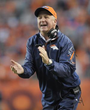 FILE - In this Monday, Sept. 23, 2013, file photo, Denver Broncos coach John Fox cheers on his players after a touchdown against the Oakland Raiders in the first quarter of an NFL football game, in Denver. Fox was taken to a hospital in the Charlotte, N.C., area Saturday, Nov. 2, 2013, after feeling light-headed while playing golf during the Broncos' bye week. (AP Photo/Jack Dempsey, File)