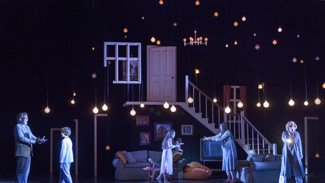 """In this Feb. 22, 2013 photo provided by the New York City Opera, cast members perform during a dress rehearsal by the New York City Opera of """"The Turn of the Screw,"""" at the Brooklyn Academy of Music in New York. From left are Dominic Armstrong as Peter Quint; Benjamin P. Wenzelberg as Miles; Lauren Worsham as Flora; Jennifer Goode Cooper as Miss Jessel and Sara Jakubiak as the Governess. (AP Photo/New York City Opera, Richard Termine)"""