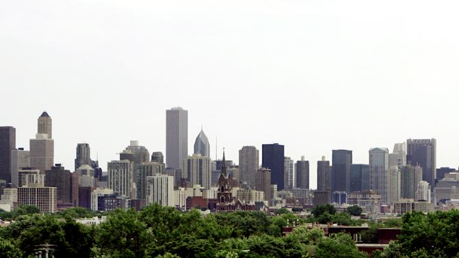 This June 23, 2006 file photo shows the Chicago skyline with the nation's tallest building, the Sears Tower, far right, now called the Willis Tower, and the John Hancock Center, left, the city's fourth highest skyscraper. Since the 9/11attacks on New York's World Trade Center a decade ago, much has changed at skyscrapers around the country, but experts say obvious precautions still leave thousands of buildings vulnerable because the costs to retrofit existing structures may be too costly and cities and states may be slow to adopt newer, tougher building codes for new construction like those recommended after the deadliest terror attack on U.S. soil. (AP Photo/M. Spencer Green, File)