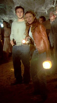 David Arquette and Kari Wuhrer in Eight Legged Freaks