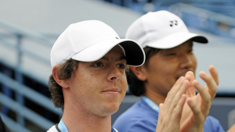 Golfer Rory McIlroy applauds after his girlfriend Caroline Wozniacki, of Denmark, defeated Petra Cetkovska, of the Czech Republic, 6-4, 6-1 in the finals of the New Haven Open tennis tournament in New Haven, Conn., on Saturday, Aug. 27, 2011. (AP Photo/Fred Beckham)