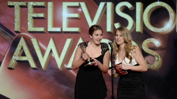 Haley Conner and Cara Gordon of So. IL University, Carbondale, College of Mass Comm. & Media Arts accepts the Magazine College Television Award onstage at the 34th College Television Awards presented by the Academy of Television Arts & Sciences Foundation at the JW Marriott Los Angeles L.A. Live on April 25, 2013 in Los Angeles, California. (Photo by Phil McCarten/Invision for the Academy of Television Arts & Sciences/AP Images)