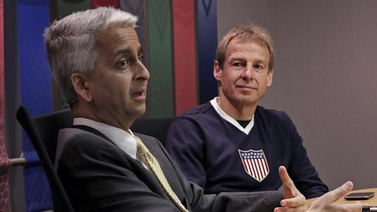 U.S. Soccer President Sunil Gulati, left, speaks as Jurgen Klinsmann, the United States men's national team soccer coach, listens during an interview Friday, April 5, 2013, in New York, (AP Photo/Richard Drew)