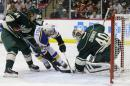 Minnesota Wild goalie Devan Dubnyk (40) covers the puck in front of St. Louis Blues defenseman Alex Pietrangelo (27) and Wild center Mikael Granlund (64), of Finland, during the second period of Game 3 of an NHL hockey first-round playoff series game in St. Paul, Minn., Monday, April 20, 2015. The Wild won 3-0. (AP Photo/Ann Heisenfelt)