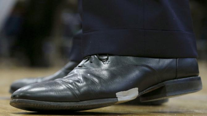 A piece of tape holds together U.S. Republican presidential candidate Jeb Bush's shoe during a campaign town hall meeting in Nashua