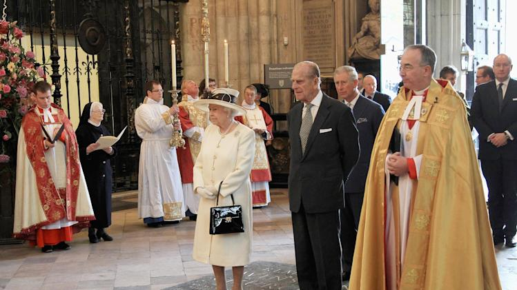 Britain's Queen Elizabeth II, Prince Philip, the Duke of Edinburgh and Prince Charles attend a service marking the 400th anniversary of the King James Bible at Westminster Abbey, London, Wednesday, Nov. 16, 2011. The first edition of the King James Bible was published in 1611  (AP Photo/Chris Jackson, Pool)