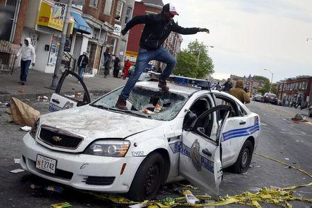 Baltimore erupts in riots after funeral of man who died in police custody