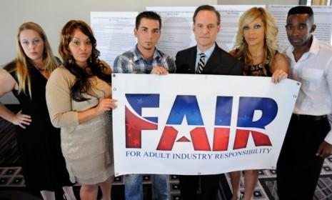 AIDS Healthcare Foundation president Michael Weinstein (center) is surrounded by former porn stars at the launch of the Los Angeles ballot initiative for mandatory condoms in adult films.