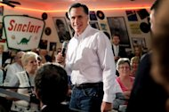 Republican presidential candidate Mitt Romney delivers remarks during a campaign stop at Charlie Parker&#39;s Diner in Springfield, Illinois. Romney is looking for a big win in President Barack Obama&#39;s home state of Illinois to knock his Republican rivals out of the race and focus his energies on the November vote