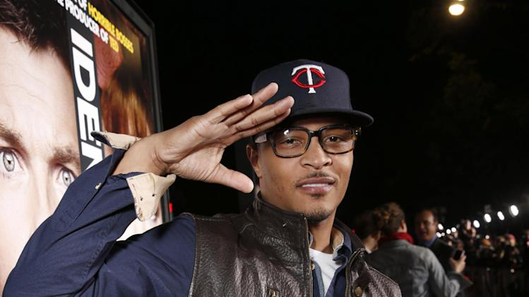 "Tip ""T.i."" Harris attends the world premiere of ""Identity Thief"" at the Mann Village Westwood on Monday, Feb. 4, 2013 in Los Angeles. (Photo by Todd Williamson/Invision/AP Images)"