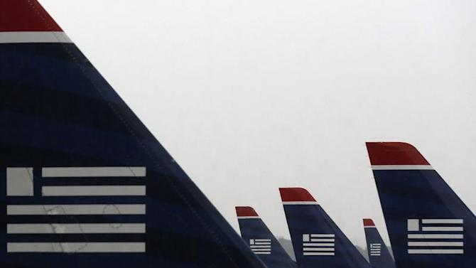 U.S. Airways jets are seen early in the morning at Reagan National Airport in Washington