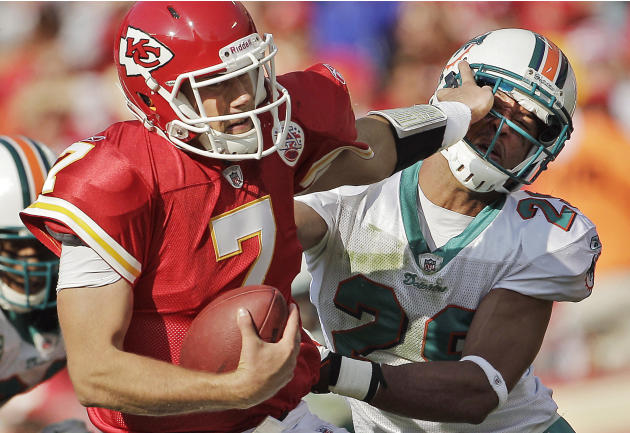 Kansas City Chiefs quarterback Matt Cassel (7) tries to keep Miami Dolphins free safety Tyrone Culver (29) at bay during the first half of an NFL football game Sunday, Nov. 6, 2011, in Kansas City, Mo