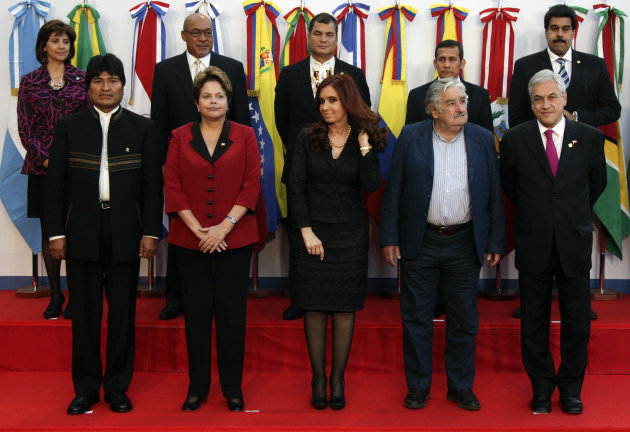 Leaders, from left to right in the front row, Bolivia&#39;s President Evo Morales, Brazil&#39;s President Dilma Rousseff, Argentina&#39;s President Cristina Fernandez, Uruguay&#39;s President Jose Mujica, Chile&#39;s President Sebastian Pinera, pose for a group photo with, back row left to right, Colombia&#39;s Foreign Minister Maria Holguin, Suriname&#39;s President Desi Bouterse, Ecuador&#39;s President Rafael Correa, Peru&#39;s President Ollanta Humala, and Venezuela&#39;s Foreign Minister Nicolas Maduro at a meeting by the Union of South American Nations (UNASUR) in Mendoza, Argentina, Friday, June 29, 2012. (AP Photo/Natacha Pisarenko)