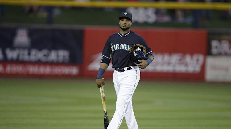 Seattle Mariners' Robinson Cano walks onto the field for a spring exhibition baseball game against the Chicago Cubs Wednesday, March 12, 2014, in Peoria, Ariz. (AP Photo/Darron Cummings)