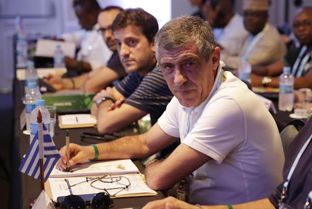 Greece head coach Fernando Santos from Portugal waits for the beginning of a seminar one day before the draw for the 2014 soccer World Cup in Costa do Sauipe near Salvador, Brazil, Thursday, Dec. 5, 2