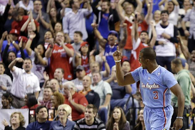 The Los Angeles Clippers' Chris Paul celebrates sinking a game-tying shot during the final seconds of the second half of a preseason NBA basketball game against the Denver Nuggets on Saturday, Oct. 19
