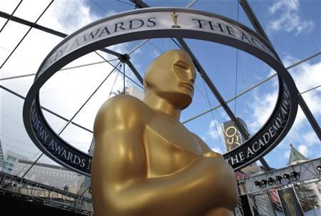An Oscar statue is seen beneath plastic sheeting during preparations for the 83rd Academy Awards in Hollywood