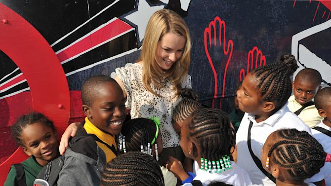 COMMERCIAL IMAGE - Sarah M. Roach Elementary School students meet Disney Channel actress and Hollywood Records recording artist, Bridgit Mendler, on Thursday, Aug. 30, 2012 in Baltimore, MD. Target and Mendler surprised the school with a $25,000 grant, $20,000 in school supplies, and a celebration as part of the Give With Target program. Learn more at http://abullseyeview.com/category/give-with-target. (Photo by Larry French/Invision for Target/AP Images)