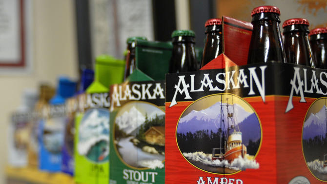 In this photo taken Jan 23, 2013, in Juneau, Alaska, are six-packs of beer displayed at the Alaskan Brewing Co. The brewery has installed a unique boiler system that burns the company's spent grain the accumulated waste from the brewing process into steam which powers the majority of the plant's operations. (AP Photo/Joshua Berlinger)