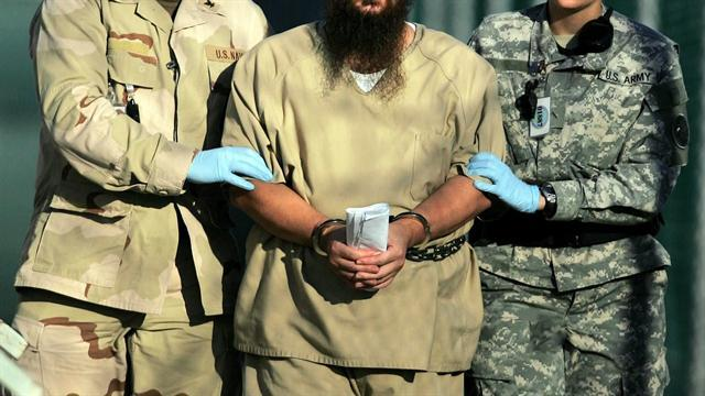 Guantanamo prisoners being force fed during hunger strike