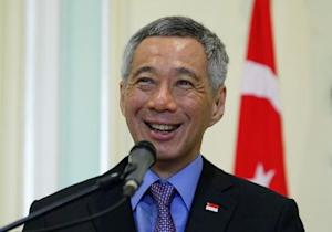 Singapore's Prime Minister Lee Hsien Loong speaks during a news conference at the Prime Minister's office in Putrajaya