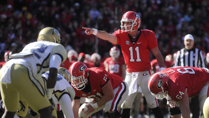 Georgia quarterback Aaron Murray (11) directs this team against Georgia Tech during the second half of an NCAA college football game, Saturday, Nov. 24, 2012, in Athens, Ga. (AP Photo/John Amis)
