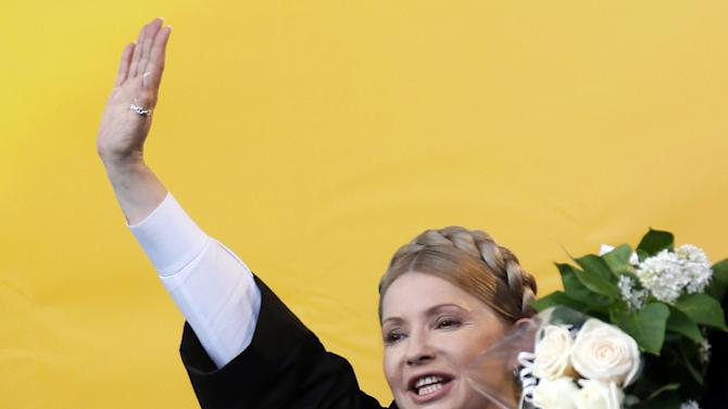 Ukraine's Presidential candidate Yulia Tymoshenko greets supporters during a campaign rally in the western Ukrainian city of Rivne on April 30, 2014