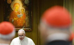 Pope Francis looks on as he arrives to lead a special consistory for the family in the Paul VI's hall at the Vatican