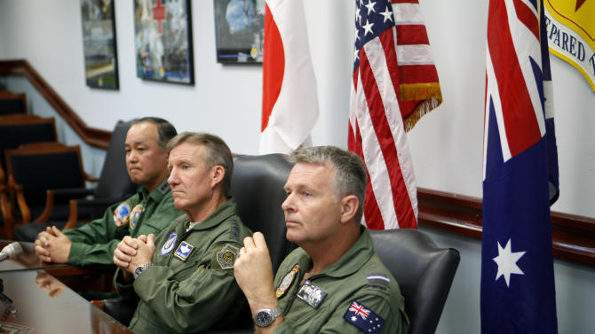 In this photo taken Monday, Feb. 4, 2013, Japanese Lt. Gen. Masayuki Hironaka, U.S. Pacific Air Forces commander Gen. Herbert Carlisle and Royal Australian Air Force Air Commodore Anthony Grady speak to the media at Andersen Air Force Base on the island of Guam to kick off the beginning of the Cope North military exercises. Fighter jets from the U.S. and two key allies roared into Western Pacific skies Thursday, Feb. 7 in the combat phase of exercises that have gained importance as the region responds to the rise of China and other potential threats. The Cope North exercises - which could soon swell in participants - are aimed at preparing the air forces of the U.S., Japan and Australia to fight together if a military crisis erupts.AP Photo/Eric Talmadge)