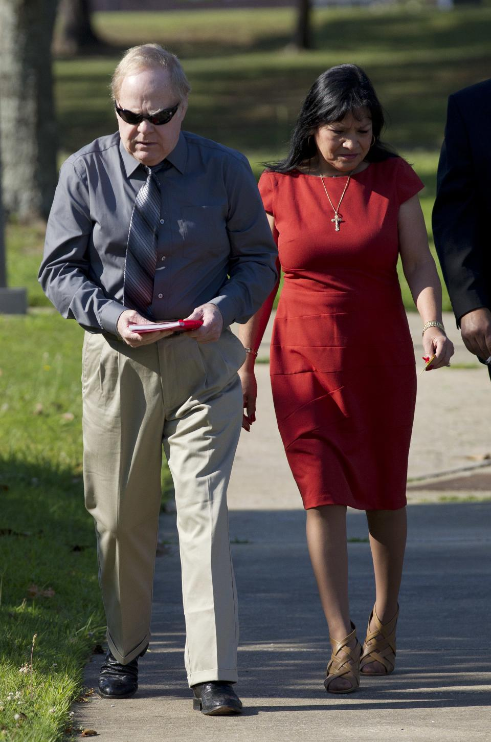 Harvey Updyke arrives with his wife Elva at the Lee County Justice Center in Auburn, Ala., Tuesday, June 19, 2012.  Jury selection is scheduled to begin in his trial where he is accused of poisoning Toomer's Corner's historic oak trees on the campus of Auburn University. (AP Photo/Dave Martin)