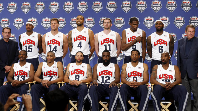 Coach Mike Krzyzewski, left, and USA Basketball chairman Jerry Colangelo, right, stand with the 12 players named to the U.S. men's basketball team, Saturday, July 7, 2012, in Las Vegas. From left in front are Chris Paul, Russell Westbrook, Deron Williams, James Harden, Andre Iguodala and Kobe Bryant. At rear are Carmelo Anthony, Blake Griffin, Tyson Chandler, Kevin Love, Kevin Durant and LeBron James. (AP Photo/Las Vegas Review-Journal, Jason Bean) LOCAL TV OUT  LOCAL INTERNET OUT   LAS VEGAS SUN OUT