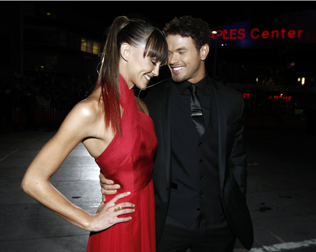 "Kellan Lutz, right, and Sharni Vinson arrive at the world premiere of ""The Twilight Saga: Breaking Dawn - Part 1"" on Monday, Nov. 14, 2011, in Los Angeles. (AP Photo/Matt Sayles)"