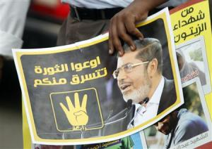 A member of the Muslim Brotherhood holds a poster during a protest in Cairo