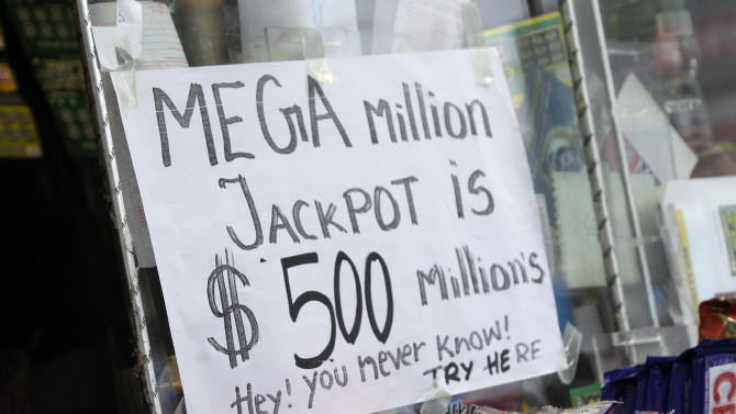 A Mega Millions lottery contestant buys his ticket for Friday's $500-million game at a corner newsstand in New York, Thursday, March 29, 2012.  Forget setting up a charity or establishing a trust, the winner of the $500 million Mega Millions jackpot could save teachers' jobs or help pay for Medicaid-funded doctor appointments in their home state just by paying taxes. (AP Photo/Richard Drew)