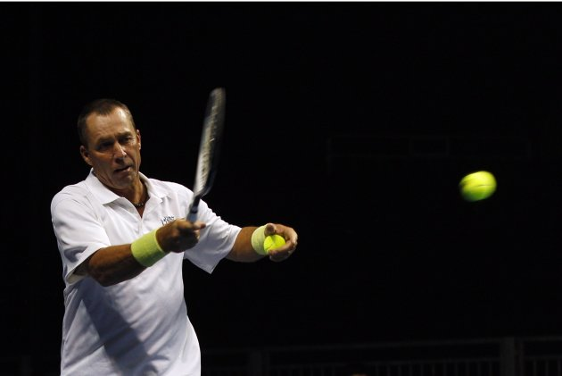 Ivan Lendl of the U.S. returns a shot to compatriot John McEnroe during their BNP Paribas Showdown friendly tennis match in Hong Kong
