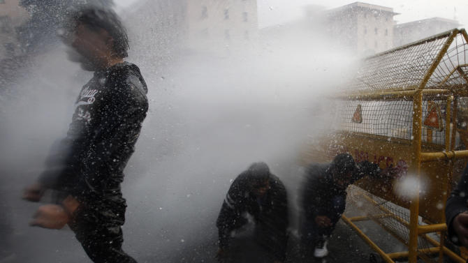Indian police use water cannon to disperse protesters demonstrating against a gang rape and brutal beating of a 23-year-old student on a bus, in New Delhi, India, Sunday, Dec. 23, 2012. The attack last Sunday has sparked days of protests across the country. (AP Photo/Tsering Topgyal)